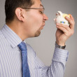 Opposite a piggy bank - Stock Photo