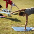 Yoga practicing outdoors — Stock fotografie