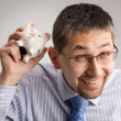 Holding a piggy bank — Stock Photo