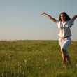 Cheerful girl on the summer field — Stock Photo