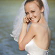 Young bride near water — Stock Photo