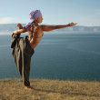 Yoga near the lake — Stock Photo