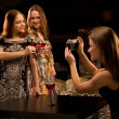 Three young woman having fun in the fancy nightclub. — Stock Photo