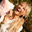 Happy girl in early autumn park with candy-floss — Stock Photo