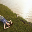 Royalty-Free Stock Photo: Young woman is lying on the break