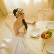 Bride is sitting at the table — Stock Photo