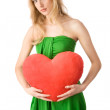 Young woman holding heart — Stock Photo