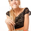 Stockfoto: Young womwith chopsticks