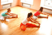Doing yoga in health club — Stock Photo