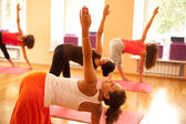Exercising at yoga class — Stock Photo