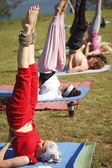 Yoga practicing outdoors — Stock Photo
