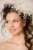 Modern bride with feather hairpin in her hair — Stock Photo