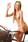 Young happy woman on bicycle — Stock Photo