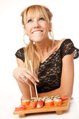 Young woman with chopsticks — Stock Photo