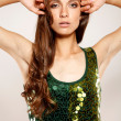 Girl in green glitter top — Stock Photo