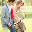 Royalty-Free Stock Photo: Young couple having fun on the bicycle