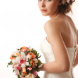 Bride glanses over her shoulder — Stock Photo