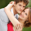 Young couple having fun in the park — Stock Photo