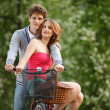 Stock Photo: Young couple having fun on the bicycle