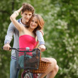 Young couple having fun on the bicycle — Stock Photo