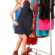 Woman is trying on dresses — Stock Photo