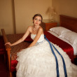 Charming bride on the bed — Stock Photo