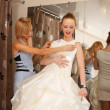 Foto de Stock  : Trying On A Wedding Dress