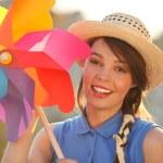 Funny girl with weather vane — Stock Photo