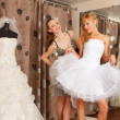 Stock fotografie: Having fun in bridal Boutique