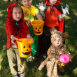 Stockfoto: Four kids trick or treating