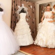 Stock Photo: Two girlfriends in bridal Boutique