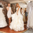 Stock Photo: Women Shopping For Wedding Dress