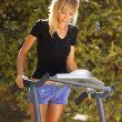 Woman on the treadmill — Stock Photo
