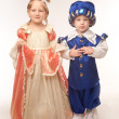 Beautiful little boy and girl in the costumes — Stock Photo