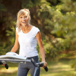 Happy woman on the treadmill — Stock Photo