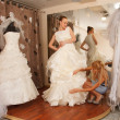 Two girlfriends in bridal Boutique — Stock Photo