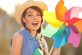 Funny girl with weather vane — Stock Photo