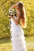 Stunning hippie bride with flowers — Stock Photo