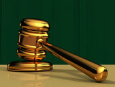 Golden Gavel with Green Background — Stock Photo