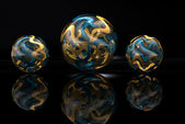 Gold and Blue Marbles — Stock Photo