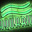 Aquarius Zodiac Sign in Neon Letters - Stock Photo