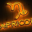 Capricorn Zodiac Sign in Neon Letters - Stockfoto