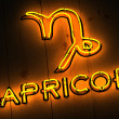 Capricorn Zodiac Sign in Neon Letters - Stock Photo