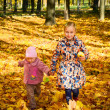 Two little girls running along the park path — Stock Photo