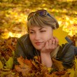 Pensive young woman relaxing in the bright autumn park — Stock Photo