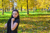 Young attractive woman walking in the park woman walking in the — Stock Photo