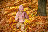 Little lovely girl playing in the park and laughing — Stock Photo