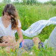 Stock Photo: Young loving couple embracing in grass