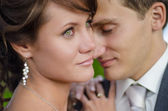 Close up portrait of a happy wedding couple — Stock Photo