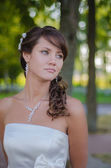 Beautiful bride is dreaming in her wedding day — Stock Photo